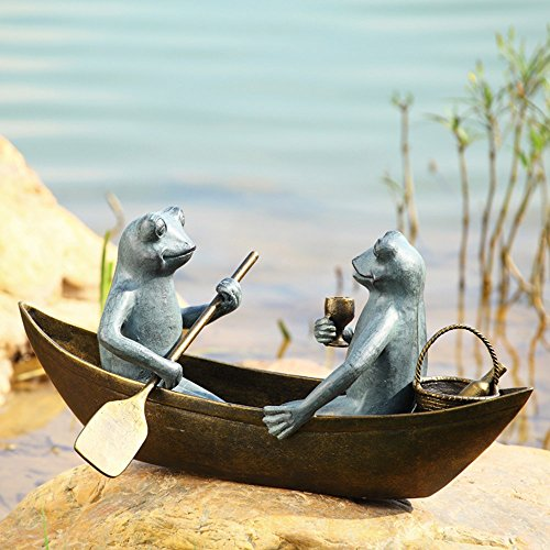 cute frogs on boat outdoor statue